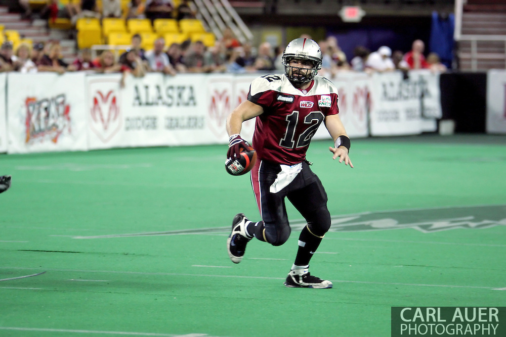 6-28-2007: Anchorage, AK - Wild quarterback David Short scrambles for a touchdown in the Alaska Wild 47 to 53 loss to the CenTex Barracudas at the Sullivan Arena...