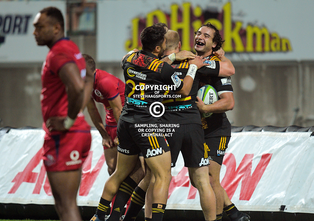 James Lowe celebrates his try during the Super Rugby match between the Chiefs and Reds at Yarrow Stadium in New Plymouth, New Zealand on Saturday, 6 May 2017. Photo: Dave Lintott / lintottphoto.co.nz