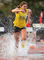 A Northern Arizona runner successfully maneuvers over the water obstacle in the steeplechase during the Bryan Clay Invitational.  Image Credit: Amanda Schwarzer