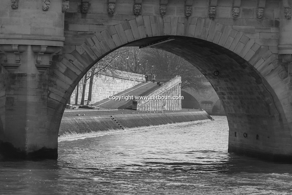 France . Paris , the quay des orfevres and the pont neuf on the Seine river