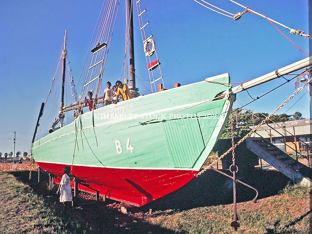 Local kids play on the lugger Sam Male in dry dock in Broome.