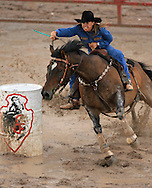 Professional Women's Barrel Racer Brenda Seely, Lander WY, clears the barrels in an impressive 19.61 seconds despite very muddy conditions, 28 July 2007, Cheyenne Frontier Days