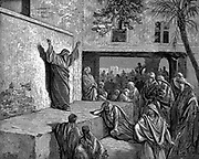 Micah the Moreshtite prophet telling the Israelites 'For, behold, the Lord cometh forth ... and will come down, and tread upon the high places of the earth.' Bible' Micah I:3. Illustration by Gustave Dore 1865-1856. Wood engraving