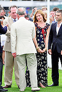 25.JULY.2010.  SURREY<br /> <br /> TOMMY LEE JONES AND CAT DEELEY GET INTRODUCED TO PRINCE CHARLES AT THE CARTIER INTERNATIONAL POLO DAY AT THE GUARDS POLO CLUB IN EGHAM, SURREY.<br /> <br /> BYLINE MUST READ : EDBIMAGEARCHIVE.COM<br /> <br /> *THIS IMAGE IS STRICTLY FOR UK NEWSPAPERS AND MAGAZINES ONLY*<br /> * FOR WORLD WIDE SALES AND WEB USE PLEASE CONTACT EDBIMAGEARCHIVE - 0208 954 5968*