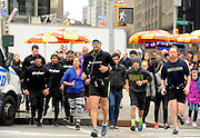 Daren Wendell, front center, and Stryker Orthopaedics employees run through New York, Friday, April 10, 2015, in support of Activewater, an organization that provides safe drinking water to African communities. Wendell received Stryker's T2 Tibia Nail in his right leg following a severe soccer injury in 2006. Despite running more than 2,903 miles with a titanium rod in his shin, he has not experienced any leg pain throughout his cross country journey, which started in Santa Monica, Ca. on January 1, 2015. (Photo by Diane Bondareff/Invsion for Stryker/AP Images)