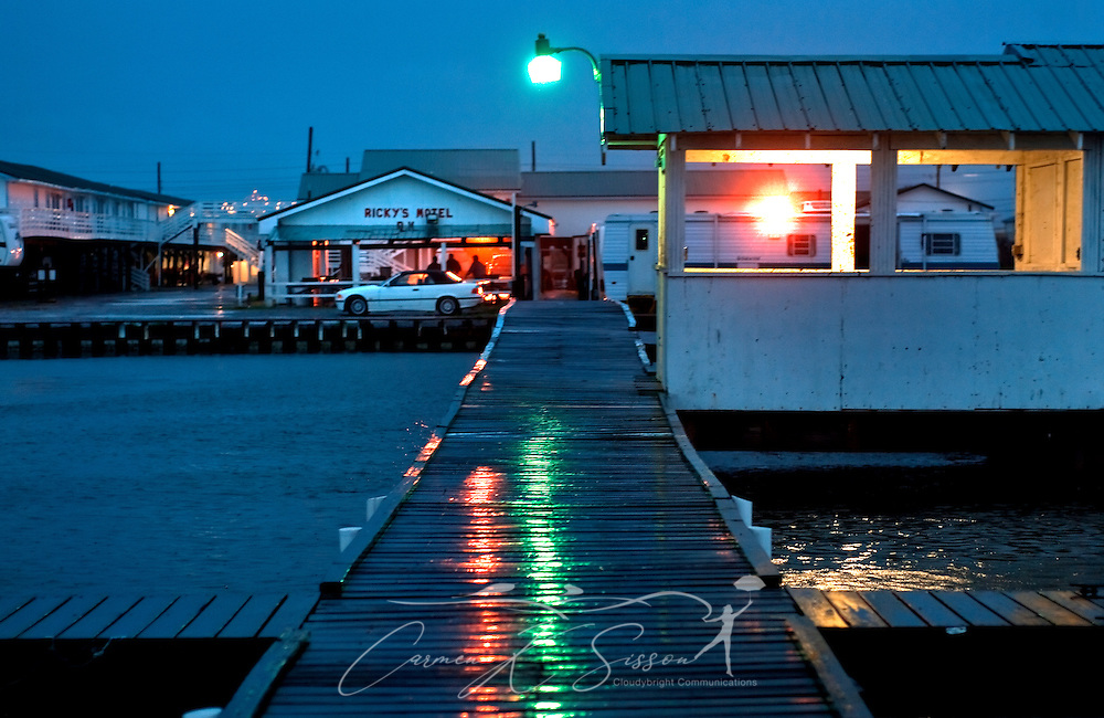 Lights reflect on a rain-slickened wharf at Ricky's Motel March 5, 2011 in Grand Isle, La. The island was heavily impacted by the Deepwater Horizon oil spill April 20, 2010 and continues to recover. (Photo by Carmen K. Sisson/Cloudybright)