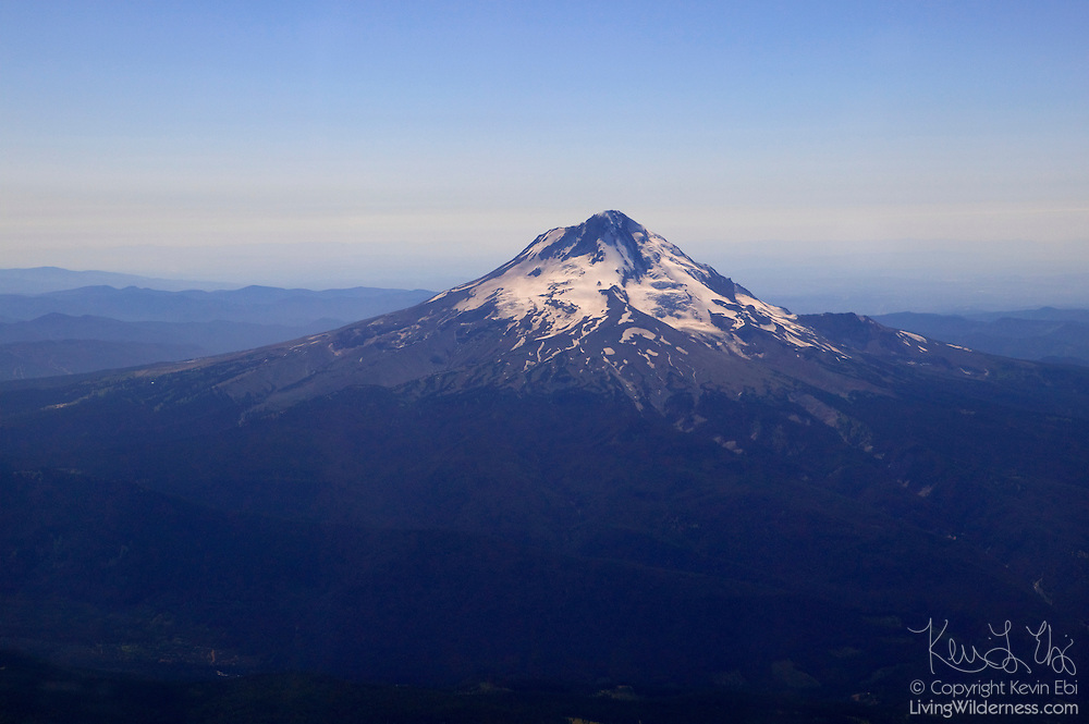 """This aerial view of Oregon's Mount Hood illustrates how rapidly it rises from sea level to 11,249 feet (3,429 m). Hood is Oregon's tallest mountain. The USGS considers it a """"potentially active"""" volcano, with as much as 7 percent chance it will erupt within the next 30 years."""