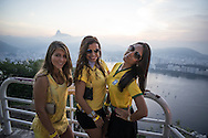 Brazilian fans at the top of Morro da Urca, the monolith that is halfway to Sugarloaf on the cable car route. The mountain was closed for a massive private party to show the Brazil v Mexico game. Scenes from Rio de Janeiro on the day that Brazil drew 0-0 with Mexico. Photo by Andrew Tobin/Tobinators Ltd