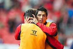 LIVERPOOL, ENGLAND - Sunday September 2, 2012: Liverpool's Luis Alberto Suarez Diaz hugs new loan signing from Real Madrid Nuri Sahin before the Premiership match against Arsenal at Anfield. (Pic by David Rawcliffe/Propaganda)