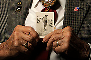 Charles Dowes, a World War II veteran and former POW, holds a photograph of himself when he was deployed in Europe. (Matt Gade/Republic)