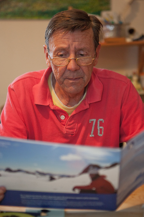 Terry Flinders looks at the brochure of the expedition
