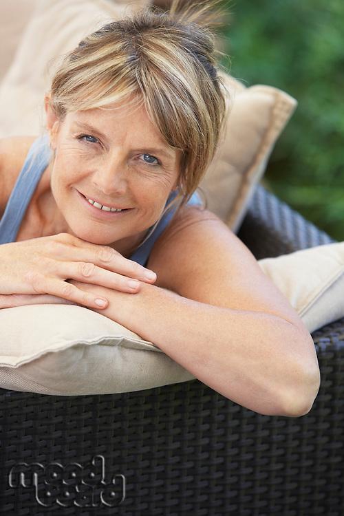 Senior Woman Relaxing in Garden