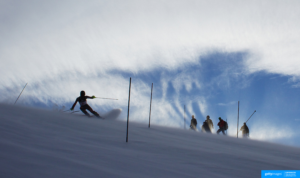 A competitor in action as the shadows of spectators reflect on the morning haze surrounding the hillside during the Women's Slalom event during the Winter Games at Cardrona, Wanaka, New Zealand, 24th August 2011. Photo Tim Clayton...