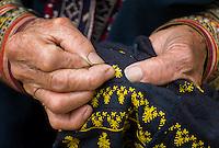 SAPA, VIETNAM - CIRCA SEPTEMBER 2014:  Detail of hands of old Red Dao woman knitting in Ta Phin Village near Sapa, North Vietnam.