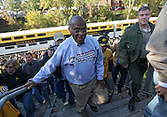 October 22, 2011: Presidential hopeful Herman Cain walks up the steps from the Hawkeye Express train before the start of the NCAA football game between the Indiana Hoosiers and the Iowa Hawkeyes at Kinnick Stadium in Iowa City, Iowa on Saturday, October 22, 2011. Iowa defeated Indiana 45-24.
