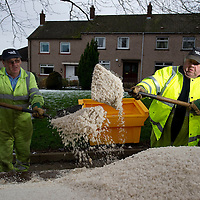 Communities in Perth & Kinross encouraged to use grit bins to help reduce impact of snow & ice....06.12.11   From left Bill Cowan and Brian Band from the roads department of Tayside Contracts at the site of a new 'grit bin' on Struan Road in Perth. The council are urging residents to use salt from their nearest grit bins to treat non-priority roads and public footways.<br /> Picture by Graeme Hart.<br /> Copyright Perthshire Picture Agency<br /> Tel: 01738 623350  Mobile: 07990 594431
