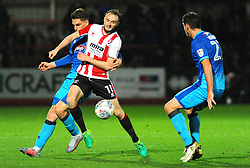 Carl Winchester jostles with Sam Jones of Grimsby Town - Mandatory by-line: Nizaam Jones/JMP- 17/10/2017 - FOOTBALL - LCI Rail Stadium - Cheltenham, England - Cheltenham Town v Grimsby Town - Sky Bet League Two