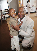 l to r: Jeff Friday and son at The ABFF Luncheon Hosted by HSBC and Rush Philanthropic Arts held at The Delano in Miami Beach on June 27, 2009..The American Black Film Festival is an industry retreat and competitve marketplace for films and by and about people of color.