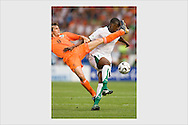 Phillip Cocu & Yaya Touré. Holland - Ivory Coast, World Cup, Stuttgart, June 16, 2006.