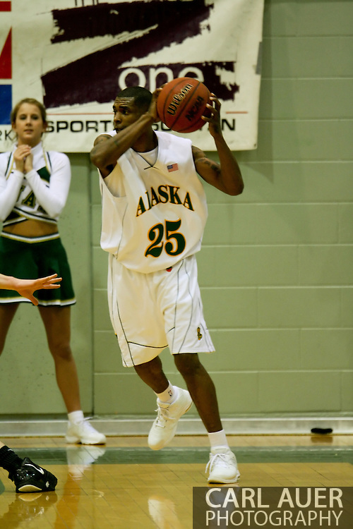1/13/2006: Senior guard Eric Draper (25) of the UAA Seawolves looks for a pass in the Alaska Anchorage comeback victory over Northwest Nazarene, 60-57, in men?s basketball action at the Wells Fargo Sports Complex on Saturday.
