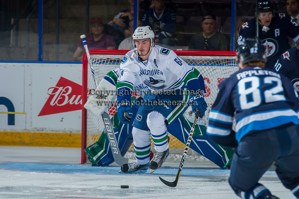 PENTICTON, CANADA - SEPTEMBER 8: Zack MacEwan #64 of Vancouver Canucks skates for the puck against the Winnipeg Jets on September 8, 2017 at the South Okanagan Event Centre in Penticton, British Columbia, Canada.  (Photo by Marissa Baecker/Shoot the Breeze)  *** Local Caption ***