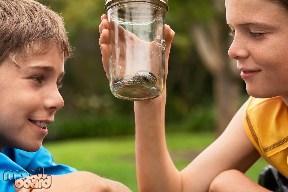 Boys Looking at Snake in Jar