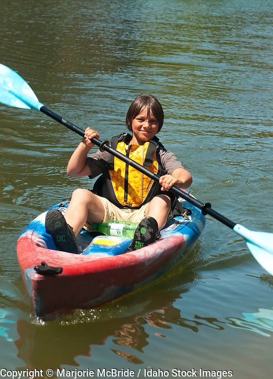 Young boy kayaking the Snake River in Twin Falls, Idaho.