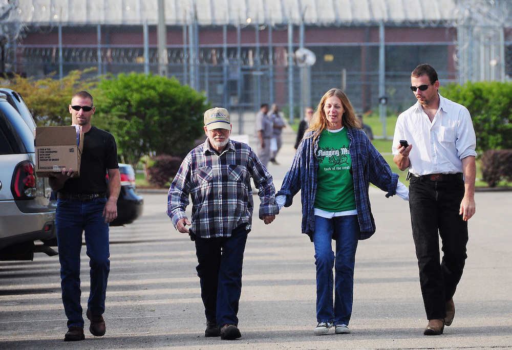 Andrew Knapp, FLORIDA TODAY -- April 1, 2011 -- Paula Carroll of Melbourne walks away from Gadsden Correctional Facility in Quincy with her son Matt Brown, left, husband Ray Brown and son Jeremy Brown after the longtime fugitive was released from the prison Friday morning.