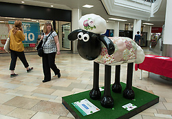 © Licensed to London News Pictures. 06/07/2015. Bristol, UK.  SHAUN THE SHEEP, 'Cecilia' designed by Laura Ashley.  The Shaun in the City trail starts today with 70 5ft tall Shaun the Sheep sculptures originally devised by Aardman Animations with these sculptures decorated by various artists.  The Shaun trail happened in London in the spring, and the Bristol Trail lasts till 31 August.  At the end of September all 120 Shaun sculptures will be viewable together in Covent Garden.  All sculptures will then go to auction on 8th October, with proceeds from the Bristol sculptures benefitting The Grand Appeal which funds pioneering medical equipment, facilities, and comforts for patients at Bristol Children's Hospital. Proceeds from the London sculptures will benefit Wallace & Gromit's Children's Charity supporting children's hospitals and hospices throughout the UK. Photo credit : Simon Chapman/LNP