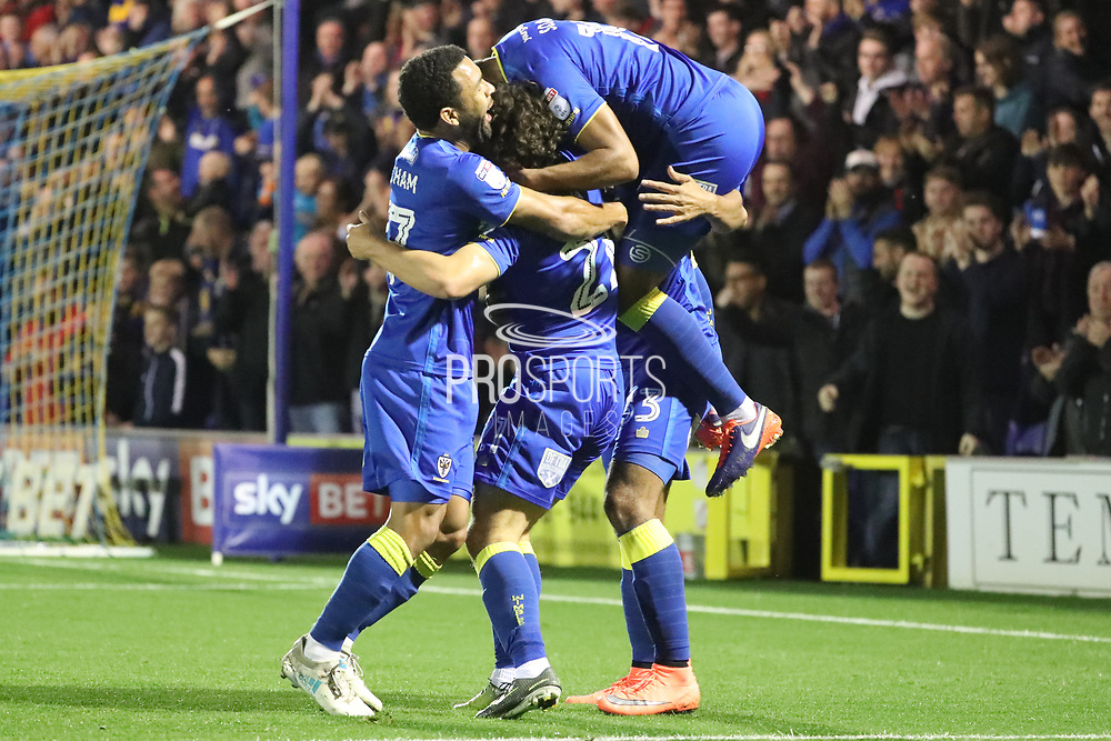 AFC Wimbledon striker Lyle Taylor (33) celebrating after scoring goal to make it 1-0 during the EFL Sky Bet League 1 match between AFC Wimbledon and Rotherham United at the Cherry Red Records Stadium, Kingston, England on 17 October 2017. Photo by Matthew Redman.