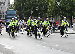 """Police officers on bikes riding past Trafalgar Square, London, as armed troops have been deployed to guard """"key locations"""" under Operation Temperer, which is being enacted after security experts warned the Government that another terrorist attack could be imminent."""