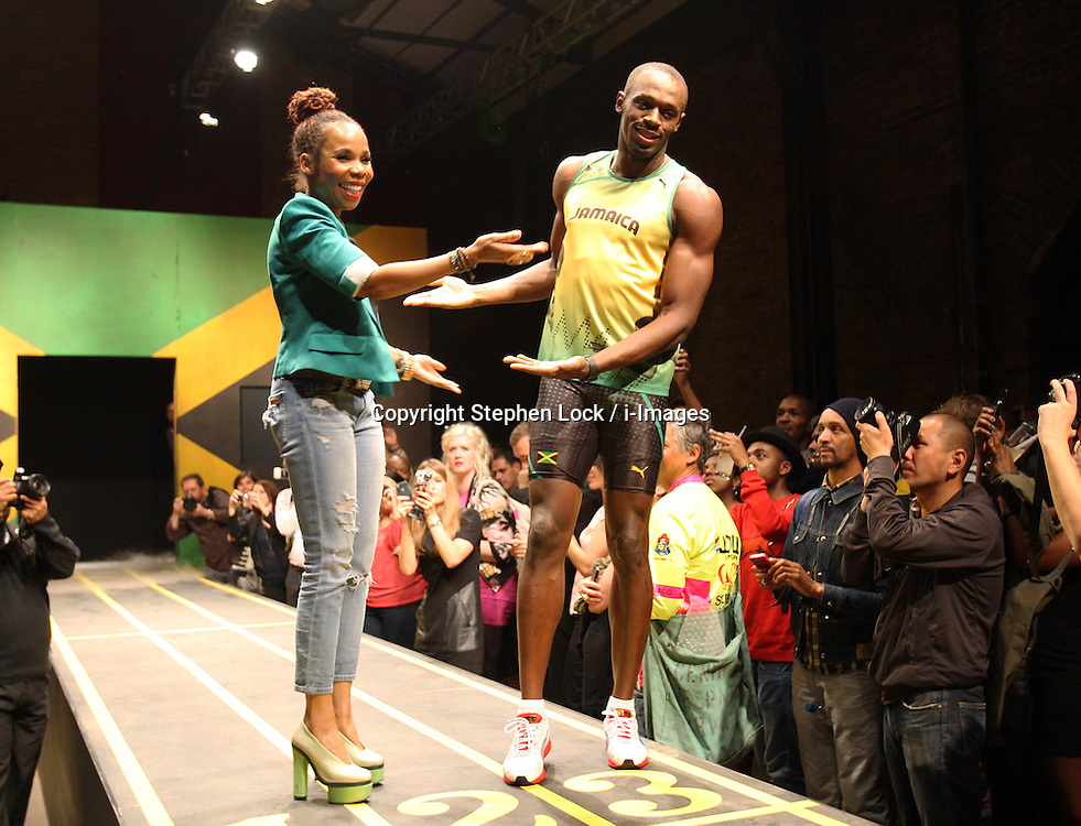 Usain Bolt and Cedella Marley (daughter of Bob Marley) at the launch of the Jamaican Olympic team kit  designed by Cedella in London, Friday,1st June 2012.  Photo by: Stephen Lock / i-Images