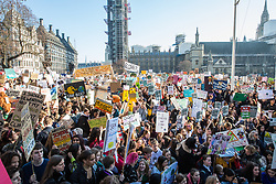 London, UK. 15th February, 2019. Thousands of students gather in Parliament Square to take part in a YouthStrike4Climate for Climate Day. Streets around Westminster were later blocked by a mixture of sit-down and moving protests for around an hour. Strike events involving schools all over the UK were organised by UK Student Climate Network and the UK Youth Climate Coalition to demand that the Government declare a climate emergency and take positive steps to address the climate crisis, including highlighting the issue as part of the school curriculum, as well as lowering the voting age to 16.