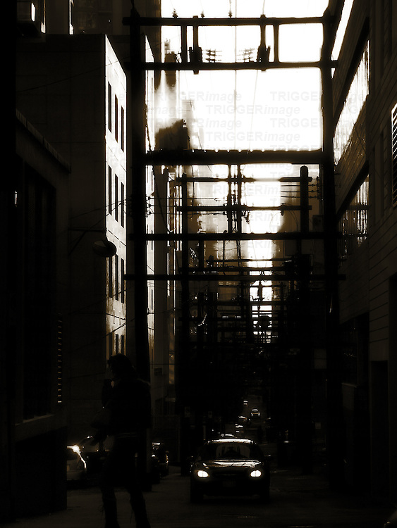 A dark alleyway with cars