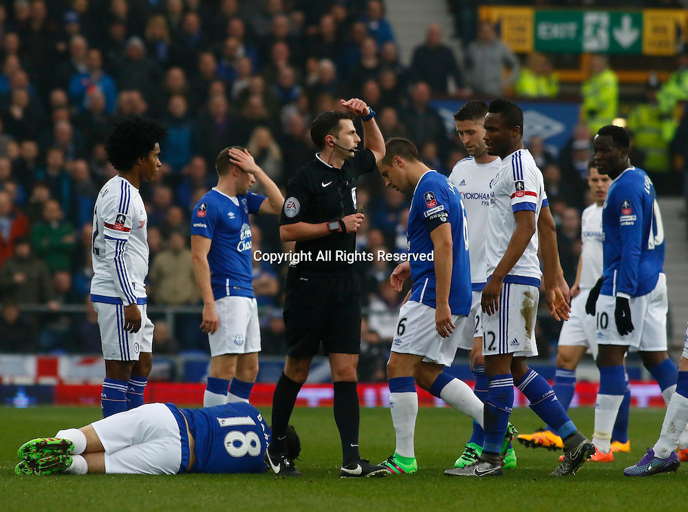 12.03.2016. Goodison Park, Liverpool, England. Emirates FA Cup 6th Round. Everton versus Chelsea. Referee Michael Oliver signals to the Everton bench as Everton captain Gareth Barry lies on the floor after a foul by Chelsea striker Diego Costa.