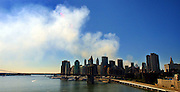 Smoke billows over Manhattan and past the Brooklyn Bridge just 5 days after terrorists destroyed the World Trade Center and surrounding buildings.