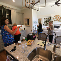 Kelly Hutsell, left, and Lisa Hawkins, right, discuss what should be done next to finish the decorating of the St. Jude Dream Home on Rowan Oak in Tupelo.