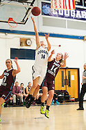 MMU's Katie Ester (14) leaps past Nroth Country's Hailey Morse (14) during the girls basketball game between the North Country Falcons and the Mount Mansfield Cougars at MMU high school on Monday night February 15, 2016 in Jericho. (BRIAN JENKINS/for the FREE PRESS)