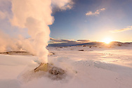 A solfatara and smoke on a sunny winter morning, geothermal area Hveravellir, Highlands, Icland