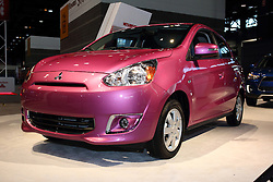 12 February 2015:   2015 MITSUBISHI MIRAGE: On display at the 2015 Chicago Auto Show is the most fuel efficient non-hybrid gasoline vehicle available in America today. We're talking a combined fuel economy of 40-mpg. Every '15 Mirage DE and Mirage ES is front-wheel drive and fitted with a fuel-sipping 1.2-liter three-cylinder DOHC engine that produces 74-horsepower. Buyers have a choice of precise shifting five-speed manual or a high-tech continuously-variable transmission (CVT).  The five-door subcompact's curb weight of just less than one ton, gives the 2015 Mirage a better power-to-weight ratio than its competitors. The Mirage offers plenty of standard equipment, along with new upscale features, and very affordable pricing. It's a great new vehicle for first-time drivers, retirees, short-hop urban dwellers or those with marathon commutes. New starting this year are side view mirrors with turn indicators, new chrome interior trim accents and new interior seat fabric. There are amenity and accessory packages available including push-button start, Bluetooth, LED Illumination, front and rear park assist sensors, exterior and chrome packages, as well as a navigation package that includes a SD Card-based navigation system with rearview camera. Other thoughtful interior design touches include several handy storage compartments/trays and large cup holders, split-fold rear seats, a generous 17.2 cubic feet of rear cargo volume and an included cover for the rear cargo area. Available fun exterior paint colors include Sapphire Blue, Kiwi Green, Infra Red, Plasma Purple, Cloud White, Mystic Black, Starlight Silver and Thunder Gray.<br /> <br /> First staged in 1901, the Chicago Auto Show is the largest auto show in North America and has been held more times than any other auto exposition on the continent. The 2015 show marks the 107th edition of the Chicago Auto Show. It has been  presented by the Chicago Automobile Trade Association (CATA) since 1935.  It is held at McCormick Pla