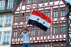 Pro-Assad demonstrators protest against against civil war in Syria and against outside involvement by the US and UN in historic Römerberg square in central Frankfurt Germany.