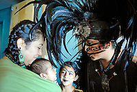 """From left, Tonaltzin Olivares (Honorable Sun), Ayolotzin Nava (Heart like Water), Acamitzin Zamora (Dart of Bamboo), and Tlakatekolotl Nava (Man Owl) before a performance at Fiesta del Mar at the Monterey Bay Aquarium. Children in the Yaocuauhtli - Eagle Warrior """"calpulli,"""" or group, are taught traditions and are participating from a young age."""