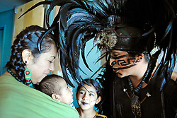 "From left, Tonaltzin Olivares (Honorable Sun), Ayolotzin Nava (Heart like Water), Acamitzin Zamora (Dart of Bamboo), and Tlakatekolotl Nava (Man Owl) before a performance at Fiesta del Mar at the Monterey Bay Aquarium. Children in the Yaocuauhtli - Eagle Warrior ""calpulli,"" or group, are taught traditions and are participating from a young age."