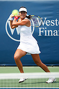 CINCINNATI, OH - AUGUST 10: Former top-ranked tennis player Ana Ivanovic of Serbia in action against Melanie Oudin of the United States during Day 1 of the Western & Southern Financial Group Women's Open on August 10, 2009 at the Lindner Family Tennis Center in Cincinnati, Ohio. Ivanovic defeated Oudin 2-6, 6-1, 6-1. (Photo by Joe Robbins)