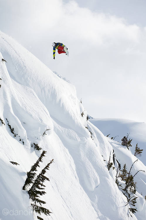 Professional snowboarder Mads Jonsson flies through the winter sky near Terrace, British Columbia, Canada.