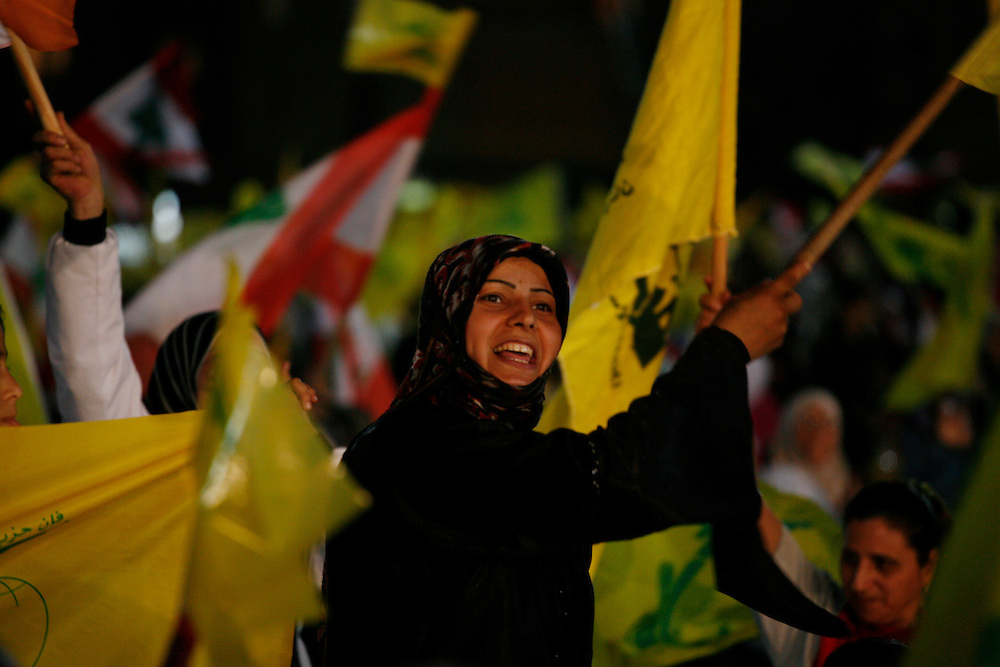 Supporters of the Shiite resistance and political group, Hizballah, rallied in the Dahiyeh southern suburbs of Beirut to watch a televised speech from Hizballah General Secretary Hassan Nasrallah. The rally was called for by Hizballah to celebrate Land Day, which is the 9th anniversary of Israel's withdrawal from southern Lebanon, which Hizballah and its supporters say was a victory over Israel. The rally comes just 13 days before Lebanese go to the polls to elect a new parliament. With Sunni Muslims and Shia Muslims mostly supporting their respective sectarian parties, Nasrallah praised Christian leader Michel Aoun. Aoun is head of the Free Patriotic Movement, which is allied with the Hizballah-led opposition March 8 coalition. ///Hizballah supporters wave the group's yellow and green flag, along with Lebanese and other flags belonging to different parties in the March 8 alliance.