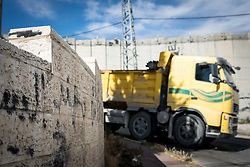 5 May 2016, Jerusalem: Truck driving by the wall dividing Israelis from Palestinians.