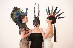 The Animal Ball..This years Animal Ball which brings the glamour and splendour of a masked soiree to the heart of London will benefit the charity Elephant Family with masks created by the likes of Christian Lacroix, Mario Testino and Swarovski. Pic Shows Natalie Ellner wearing her creation 'Lady Peacock', Katherine Aplin wearing a creation by Faux Tale and Lucy Franks wearing Mario Testino. The masks will be on show at Sotheby's until May 15th, London, UK, May 10, 2013. Photo by:  i-Images