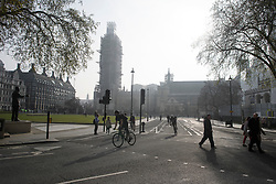© Licensed to London News Pictures. 18/04/2019. London, UK. Roads empty of cars as Extinction Rebellion campaigners occupy Parliament Square in London on a fourth day of protests by the group. Protesters are demanding urgent government action on climate change. Photo credit: Ben Cawthra/LNP