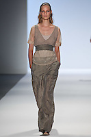 A model walks the runway wearing Richard Chai Spring 2011 Collection during Mercedes Benz Fashion Week in New York on September 9, 2010
